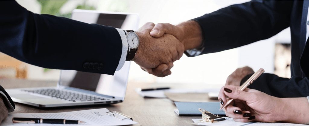 two people shaking hands as they do business