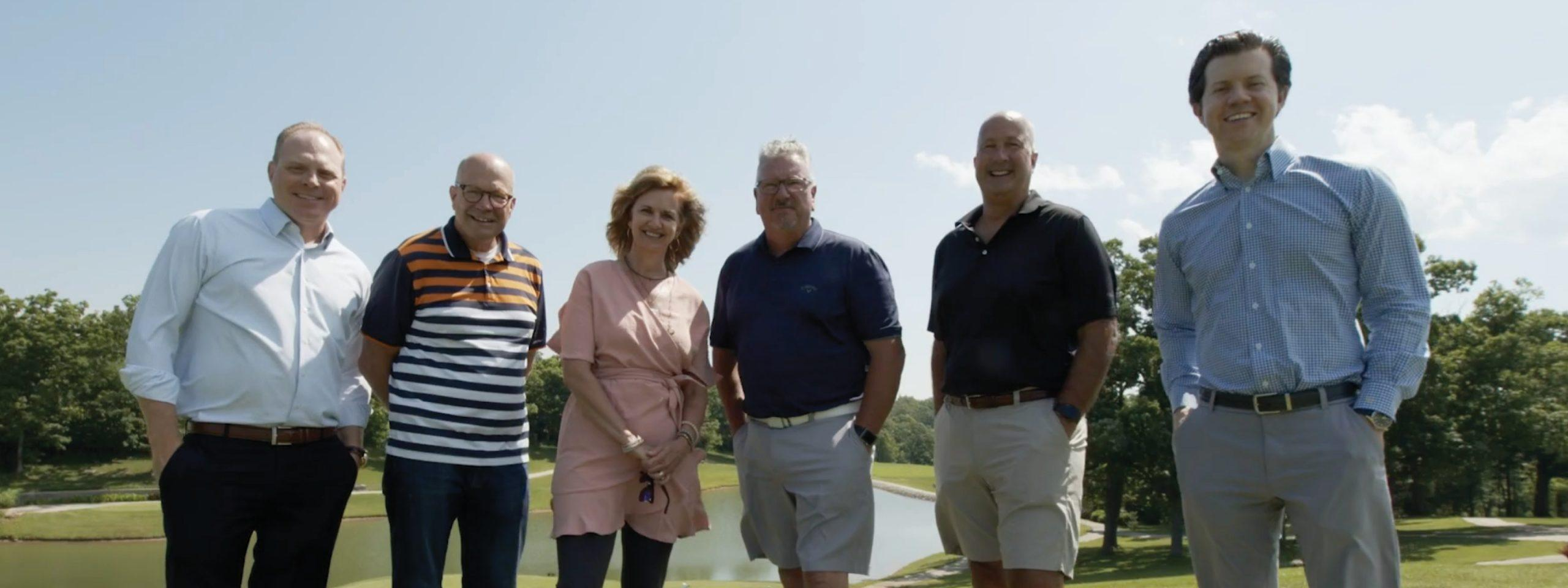 McNerney Management Group and Integrity Marketing Group standing for photo